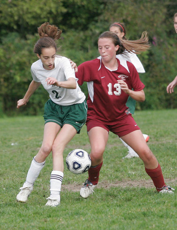 Manchester: Manchester Essex's Kirsten Coale and Rockport's Laura Donnelly battle for the ball during their matchup at Sweeney Field yesterday. Photo by Kate Glass/Gloucester Daily Times Wednesday, September 16, 2009