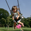 Manchester: Syndey Bartlett, 2, swings high up into the air while playing on the swings at Masconomo Park Saturday afternoon. Sydney kept telling her mother that she wanted to go high up in the sky like a bird. Mary Muckenhoupt/Gloucester Daily Times