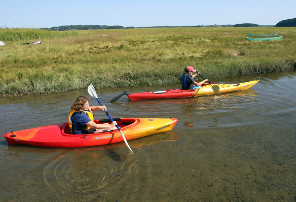 Essex: Karen Safford, left, and Eileen Hardy, right, of Essex launch their kayaks off Island Road in Essex on Wednesday morning. Photo by Kate Glass/Gloucester Daily Times Wednesday, September 2, 2009