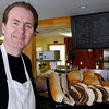 "Gloucester: Daniel MacIntyre recently opened Culina Cafe on Washington Street in the building that was most recently the home of Andiamos. Right now the cafe sells take-out salads and sandwiches, but MacIntyre hopes to expand by adding a few tables and delivery. ""The neighbors have been more welcoming here than anywhere I've been in 32 years in the business,"" he says. Photo by Kate Glass/Gloucester Daily Times Monday, September 7, 2009"