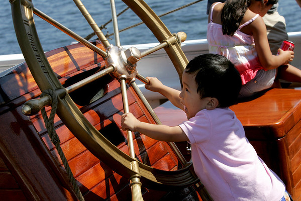 Gloucester: Daniel Yook, 3, tries his hand at the wheel of the Bluenose II while touring the schooner with his family Saturday afternoon.  Mary Muckenhoupt/Gloucester Daily Times