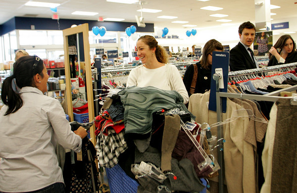 Gloucester: Roxanne Costello of Essex stops to chat with Amy Benjamin, right, as Costello heads toward the fitting rooms with her shopping cart piled high with clothes while shopping at Marshalls Thursday morning. Mary Muckenhoupt/Gloucester Daily Times