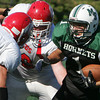 Manchester: Manchester Essex's Ben Kekeisen gets blocked by Saugus's John Moore, left, and Andrew White during the second quarter of the football game at Coach Ed Field Field Saturday. Manchester Essex defeated Saugus 33-20 Mary Muckenhoupt/Gloucester Daily Times
