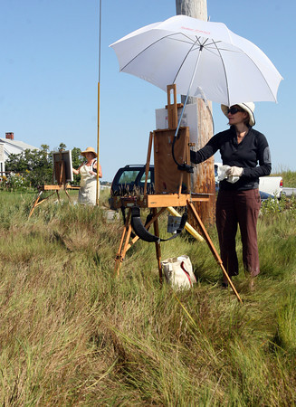 Essex: Heather Johnson Reid, right, and Cheryl Dyment, paint marsh landscapes off Island Road in Essex Wednesday morning. The two always paint together and finish their summer scenes in Dyment's studio during the winter. Photo by Kate Glass/Gloucester Daily Times Wednesday, September 2, 2009