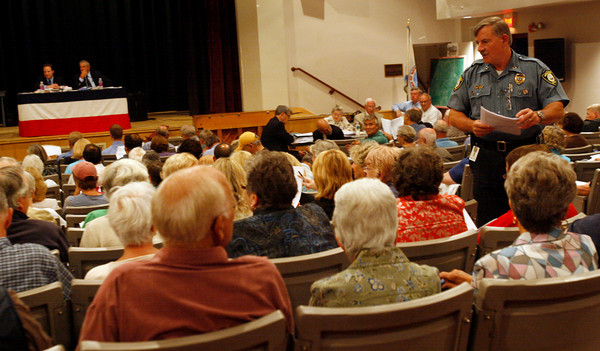 Rockport: Rockport Police Chief Tom McCarthy hands out copies of items on the agenda during town meeting at the High School Auditorium last night. Photo by Kate Glass/Gloucester Daily Times Monday, September 14, 2009
