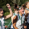 Manchester: Team manager Nicole Brosch, left, cheers as Amelia Cohen makes a stroke, field hockey's equivalent to a penalty shot, in the last minute of the field hockey game making the score 5-0 against Ipswich at Coach Ed Field Field Wednesday. Also pictured from left of Brosch, Lizzie Ball, Tatiana Lyne and Patty Wright. Mary Muckenhoupt/Gloucester Daily Times