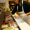 Gloucester: Silvana Ferreira prepares a sandwich at Culina Cafe, which recently opened in the former location of Andiamos. Owner Daniel MacIntyre says he is keeping prices as low as possible and is focusing on fresh ingredients. Photo by Kate Glass/Gloucester Daily Times Monday, September 7, 2009