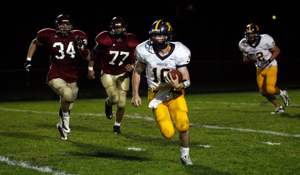 Gloucester: Andover quarterback John Hennessy carries the ball during their loss to Gloucester yesterday. Photo by Kate Glass/Gloucester Daily Times Thursday, September 17, 2009