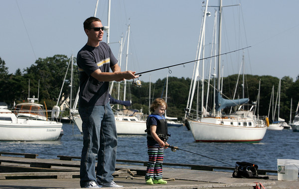 Manchester: Nate Stein and his daughter Ella, 3, wait fora bite while fishing at Tuck's Point Friday afternoon. Mary Muckenhoupt/Gloucester Daily Times