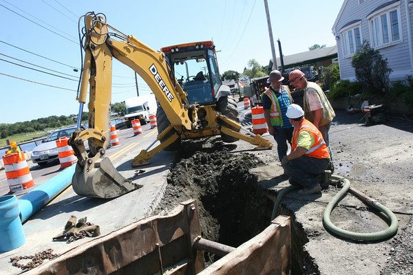Essex: Employees of J Marchese & Sons redirect the water main running under the Causeway to prepare for work on the sea wall. Work on the wall is expected to begin in the next couple weeks and construction will temporarily hault around Thanksgiving. Photo by Kate Glass/Gloucester Daily Times Tuesday, September 1, 2009