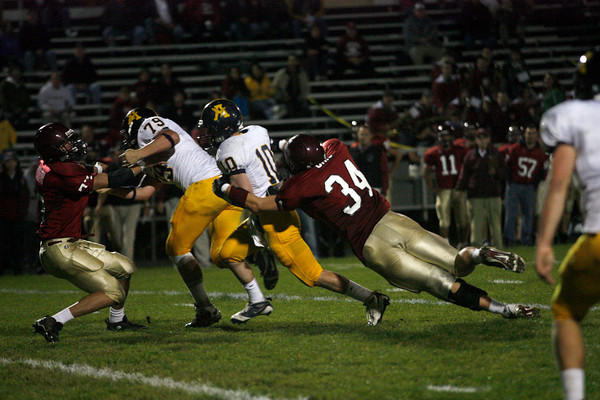 Gloucester: Gloucester's Andrew Mizzoni blocks Andover's Kris Riemer as teammate Chris Unis sacks Andover quarterback John Hennessy at Newell Stadium last night. Photo by Kate Glass/Gloucester Daily Times Thursday, September 17, 2009