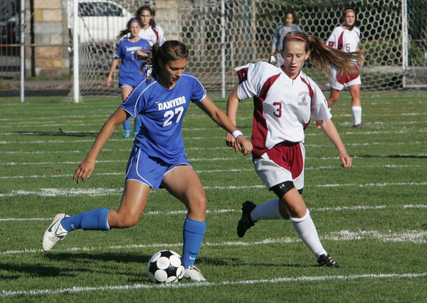 Gloucester: Danvers' Gabby Vega gets to the ball ahead of Gloucester's Kali Cook during the soccer game at Newell Stadium Friday afternoon. Mary Muckenhoupt/Gloucester Daily Times