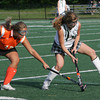 Gloucester: Manchester Essex's Olivia Dumont keeps the ball away from Ipswich's Mikhala Reedy during the field hockey game at Coach Ed Field Field Wednesday afternoon. Manchester Essex defeated Ipswich 5-0. Mary Muckenhoupt/Gloucester Daily Times
