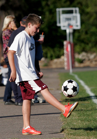 Rockport: Andrew Wayrynen, 11, juggles a soccer ball at the Rockport boys soccer game Tuesday afternoon. Wayrynen has been a ball boy for the team for over a year and says he hasn't missed a game. Photo by Kate Glass/Gloucester Daily Times Tuesday, September 15, 2009