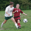 Manchester: Rockport's Kaitlyn Keough gets to the ball just ahead of Manchester Essex's Sylar Coons during their matchup at Sweeney Field yesterday. Photo by Kate Glass/Gloucester Daily Times Wednesday, September 16, 2009