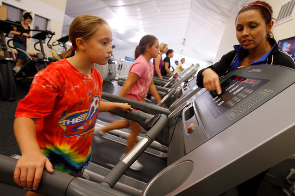 Manchester: Emma Dawson of Ipswich learns how to use the treadmill at the Manchester Athletic Club with personal trainer Janelle Nicolo. Dawson is considering competing in the First Annual Essex Youth Triathlon on October 11th. Photo by Kate Glass/Gloucester Daily Times Wednesday, September 30, 2009