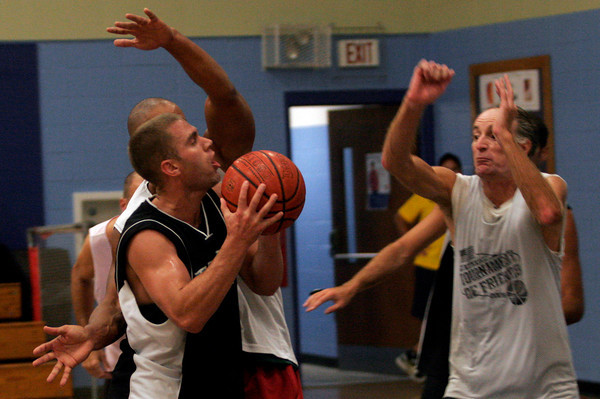 Gloucester: Flynn's Physical Therapy's Ryan Flynn tries to get the ball past Crow's Nest's Rob Breckenridge and Greg Sousa during the Cape Ann YMCA Summer League Championship last night. Photo by Kate Glass/Gloucester Daily Times Tuesday, September 1, 2009