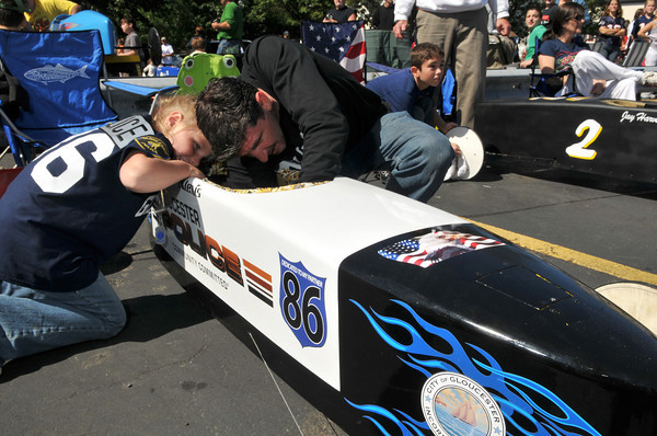 Gloucester: Russell Morris and his daughter Alexis 8, make some adjustments before their race in the modifide class in the Fish Box Durby Sunday afternoon on Rodger St.Desi Smith Photo/Gloucester Daily Times. September 20,2009.