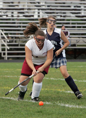 Gloucester: Gloucester's Emily Interrante keeps ahead of Revere's Noelle Balli during the field hockey game held at Newell Stadium Friday afternoon. Mary Muckenhoupt/Gloucester Daily Times