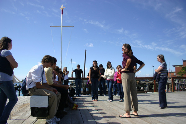 Gloucester: Amanda Madeira, schooner captain and instructor at the Gloucester Maritime Heritage Center, talks about Gloucester Harbor while giving a tour of the center to students from Gloucester High School and Germany, who are participating in a ten day exchange program.<br /> Gloucester Daily Times/Silvie Lockerova