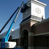 Gloucester: Workers install siding on Market Basket's clock tower. Market Basket is scheduled to open in October. Photo by Kate Glass/Gloucester Daily Times Monday, September 14, 2009