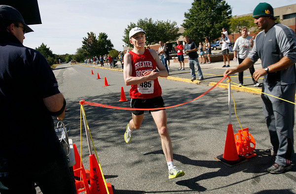Gloucester: Ryan Aschbrenner crosses the finish line of the 76th Around Cape Ann 25K Road Race yesterday morning. Photo by Kate Glass/Gloucester Daily Times Monday, September 7, 2009