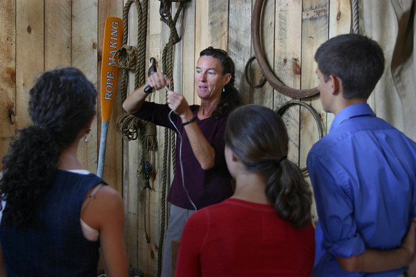 Gloucester: Amanda Madeira, instructor at the Heritage Center and Scooner captain, explains how to make a rope to students from Gloucester HIgh School and students from Germany Bad Camberg Tamus Schule, which are participating on ten days exchange program.<br /> Gloucester Daily Times/Silvie Lockerova
