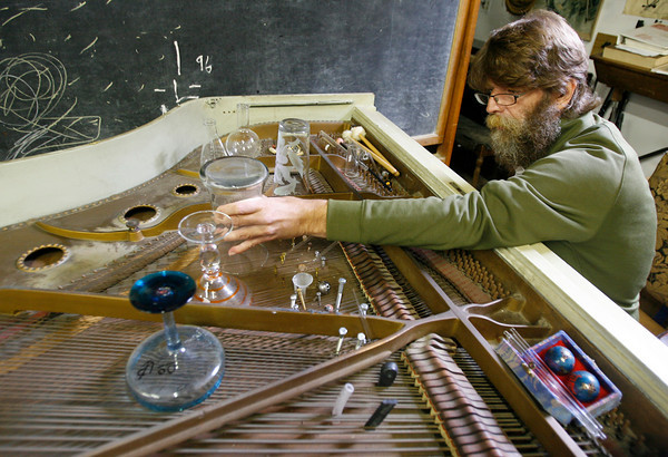 Stephen Hastings-King plays a prepared piano, which has been musically transformed by inserting various objects with the strings. The piano will be the main performance at the 5th Gloucester New Arts Festival at Stage Fort Park on Saturday evening. Photo by Kate Glass/Gloucester Daily Times Tuesday, September 22, 2009