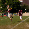 Gloucester: Senior Conor Ressel leaps to catch the ball during practice. Photo by Kate Glass/Gloucester Daily Times Tuesday, September 8, 2009