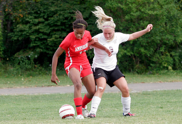 Rockport: Rockport's Tasha Radzynski tries to steal the ball from Amesbury's Whitney Whitlow during their game at Rockport yesterday. Photo by Kate Glass/Gloucester Daily Times Wednesday, September 22, 2009