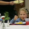 Gloucester: Breanna Jackson eats up the squash on her plate while enjoying her chicken dinner during the fundraiser dinner for the class of 2013 at Rockport High School cafeteria Wednesday night. Breanna thought she was eating carrots until her mother informed her after she had finished  that she was eating squash.  Mary Muckenhoupt/Gloucester Daily Times