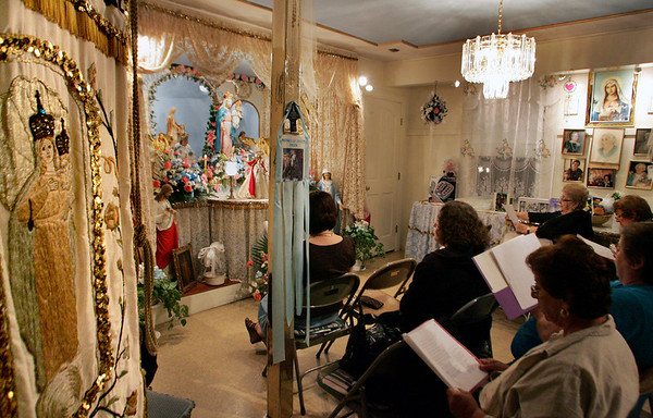 Gloucester: Women pray during the first night of a nine day novena inside the Mother of Grace Club Wednesday night.  Novena's are held every afternoon and evening leading at the Mother of Grace Club on Washington Street before the Fiesta is held.  Mary Muckenhoupt/Gloucester Daily Times