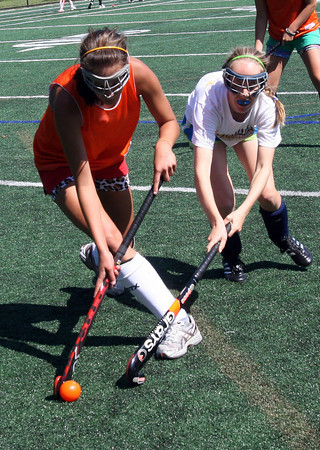 Manchester: Hornets Kyle Marsh, left, and Caroline Moore battle for the ball during practice. Photo by Kate Glass/Gloucester Daily Times Wednesday, September 2, 2009