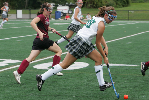 Manchester: Manchester Essex's Amelia Cohen runs down the field with the ball during the field hockey game against Rockport at Coach Ed Field Field Wednesday afternoon. Mary Muckenhoupt/Gloucester Daily Times