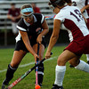 Gloucester: Salem's Rachel Channen tries to knock the ball past Gloucester's Kristine Bandoni during their 2-1 loss at Newell Stadium last night. Photo by Kate Glass/Salem News Monday, September 14, 2009