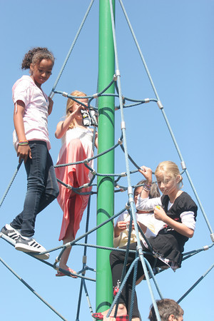 From left to right: 5th graders Nicole Felder, Inga Nilsson, Sheri Blais and Katie Favaloro enjoy their first recess of the school year at Rockport Elementary on one of the many climbing spots on the playground. Photo by Maria Uminski