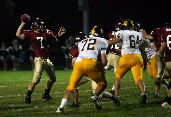 Gloucester: Gloucester quarterback Brett Cahill looks for an open teammate during their game against Andover at Newell Stadium last night. Photo by Kate Glass/Gloucester Daily Times Thursday, September 17, 2009