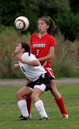 Rockport: Rockport's Julia Sanfilippo gets under the ball as Amesbury's Danielle Sylvester backs away during their game at Rockport yesterday. Photo by Kate Glass/Gloucester Daily Times Tuesday, September 22, 2009
