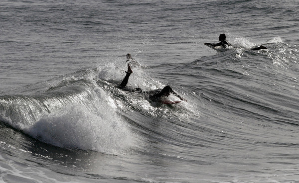 Rockport: Three surfers try to catch the waves off Cape Hedge Beach on Thursday afternoon, but the wind was not favorable, making them difficult to ride. Photo by Kate Glass/Gloucester Daily Times Thursday, September 10, 2009