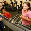 Manchester: Janelle Nicolo, a personal trainer at the Manchester Athletic Club, watches as McKenzie Plante runs on the treadmill to get ready for the First Annual Essex Youth Traithlon, which is on October 11th. Photo by Kate Glass/Gloucester Daily Times Wednesday, September 30, 2009