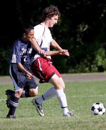Gloucester: Rockport's Cam Tibert gets past Pope John's Harry to score the team's first goal during their game at Rockport yesterday. Photo by Kate Glass/Gloucester Daily Times Tuesday, September 15, 2009