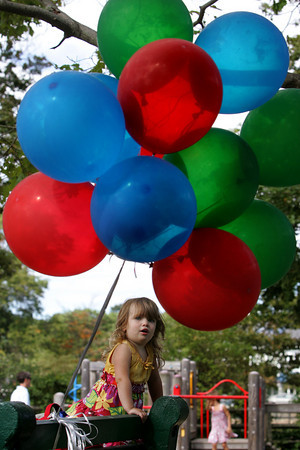 Manchester: Sydney Bartlett, 2, of Manchester can't take her eyes of the bunch of balloons that were tied to a bench at Masconomo Park Thursday afternoon. The balloons were at the park for a birthday party to be given out as party favors. Mary Muckenhoupt/Gloucester Daily Times
