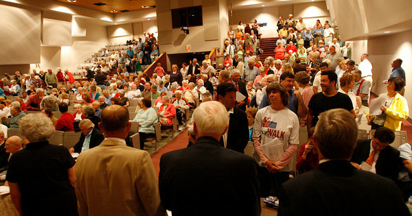 Rockport: Rockport voters stand in sections to cast their vote for discussing the articles regarding the Community House and Granite Savings Bank first during town meeting at the High School Auditorium last night. Photo by Kate Glass/Gloucester Daily Times Monday, September 14, 2009
