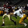 Gloucester: Gloucester's Conor Ressel dodges Andover's Craig Homung on one of his many carries last night. Photo by Kate Glass/Gloucester Daily Times Thursday, September 17, 2009