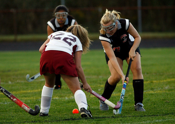 Gloucester: Salem's Rachel Disick and Gloucester's Katie Mituige battle for the ball at Newell Stadium last night. Photo by Kate Glass/Salem News Monday, September 14, 2009
