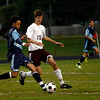 Gloucester: Peabody's Lucas Deoliveira dribbles around Gloucester's Brian Theriault during their game at Newell Stadium last night. Photo by Kate Glass/Gloucester Daily Times Tuesday, September 29, 2009