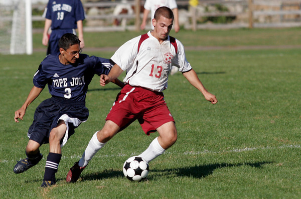Rockport: Rockport's Scott Noble dribbles around Pope John's Harry Singh during their game at Rockport yesterday. Photo by Kate Glass/Gloucester Daily Times Tuesday, September 15, 2009