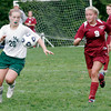 Manchester: Manchester Essex's Abbi Biggar controls the ball as Rockport's Tasha Radzynski tries to take it away during their matchup at Sweeney Field yesterday. Photo by Kate Glass/Gloucester Daily Times Wednesday, September 16, 2009
