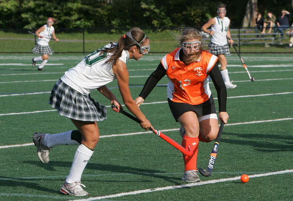 Manchester: Manchester Essex's Kyle Marsh and Ipswich's Kelley Michael fight for possesion of the ball during the field hockey game at Coach Ed Field Field Wednesday afternoon.  Manchester Essex defeated Ipswich 5-0. Mary Muckenhoupt/Gloucester Daily Times