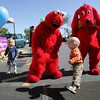 Gloucester: Billy Nixon, 2, dances with Elmo and Clifford the Big Red Dog  with his cousins Lainey Moseley and Davi-Lee Moseley, left, during Customer Appreciation Day at Stop and Shop Saturday morning. Mary Muckenhoupt/Gloucester Daily Times